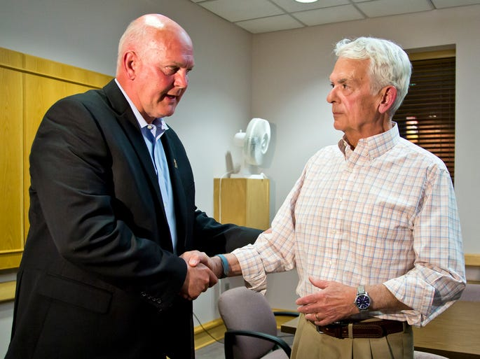 Barry Richard, left, shakes hand with opponent Dave Heath after defeating Heath for the GOP nomination for sheriff of Tippecanoe County  Tuesday, May 6, 2014, at the Tippecanoe County office building in Lafayette.