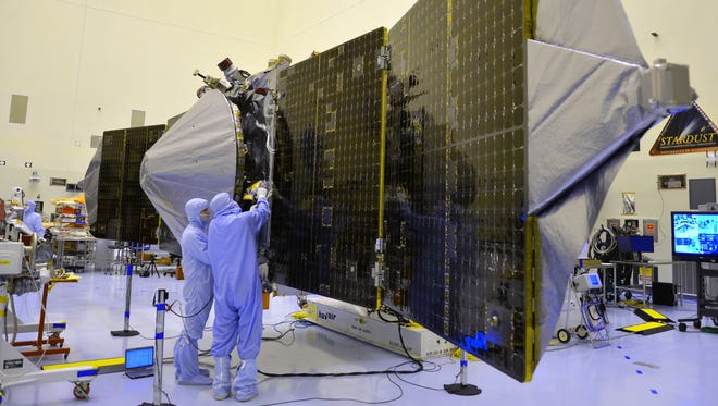 Techicians at Kennedy Space Center do final testing and preparations to the Maven spacecraft, designed to orbit Mars and make scientific measurements.