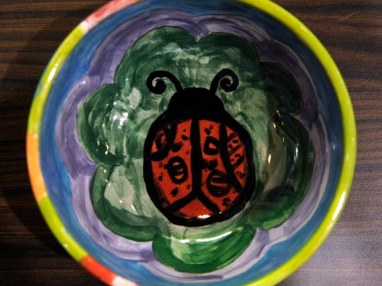 A ladybug bowl made by local radio personality Stephanie Gade is displayed at the Empty Bowls Project in Brownwood. Gade's bowl was among those sold in the celebrity auction, which raised additional money during the fundraiser for Brown County hunger relief programs.