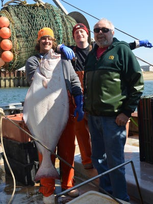 The fishing vessel Ellen Diane caught a 60-pound halibut in the spring, which was sold fresh at the Yankee Fishermen's Coop in Seabrook. Pictured are crew members Eric Graham, Matthew Lavigne and Captain David Goethel.