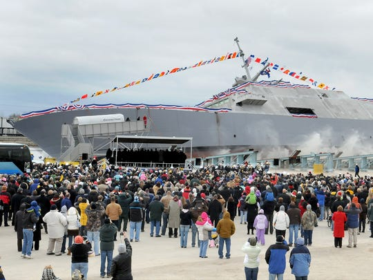 The U.S. Navy launches the USS Fort Worth, a littoral combat ship during a ceremony at Marinette Marine Corp. in 2010.