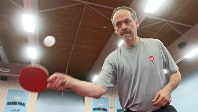 New York Times crossword editor Will Shortz plays his 1,000th consecutive day of table tennis at the Westchester Tennis Club in Pleasantville on Tuesday. Shortz, who owns the club, has played most of the 1,000 days there but has had to find available table tennis tables as well as playing partners on days when he has been traveling.