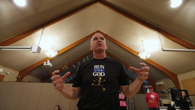 Dave Hickey of Stanhope teaches proper stretching techniques during a Run for God workshop at Grace Church in Netcong.