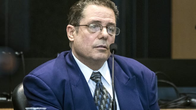 William Dabbs testifies in his own defense Thursday, Feb. 6, 2020, during his retrial in the 2011 shooting death of his 41-year-old boss, Larry Modena.