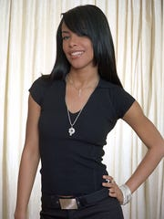 FILE-- R&B singer and actress Aaliyah poses for a photo in New York, in this May 9, 2001 file photo.  Aaliyah died Saturday, Aug. 25, 2001, when a small plane that was to carry her and eight others back to the United States crashed after takeoff in the Bahamas, authorities said.