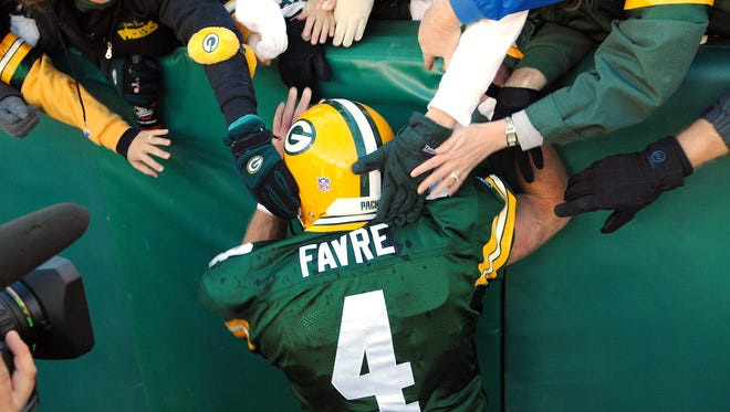 Brett Favre celebrates with fans after running for a touchdown during the Packers game against the Cardinals at Lambeau Field on Sunday, Oct. 29, 2006.