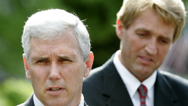Reps. Mike Pence, R-Ind., and Jeff Flake, R-Ariz., were close colleagues in the mid-2000s but have taken different paths when it comes to Donald Trump. They are seen speaking with reporters outside the White House after meeting with President George W. Bush in April of 2005.