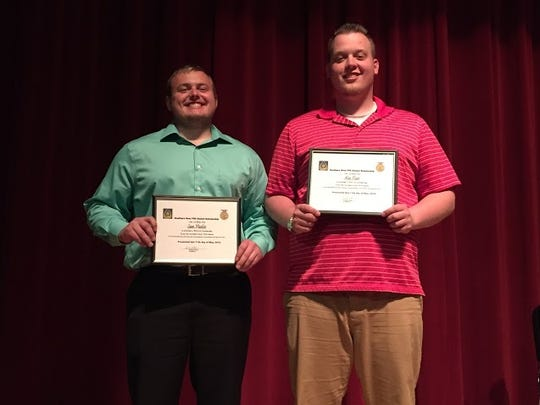 Southern Door High School seniors Samuel Mueller, left, and Alex Ploor were recognized during the recent FFA awards banquet.  Mueller received the DEKALB Agricultural Accomplishment Award and Ploor received the FFA honor graduation cords. Both students were awarded scholarships from the Southern Door FFA Alumni.