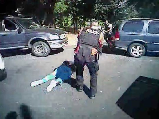This image made from video provided by the Charlotte-Mecklenburg Police Department on Saturday, Sept. 24, 2016 shows Keith Scott on the ground as police approach him in Charlotte, N.C., on Sept. 20, 2016.