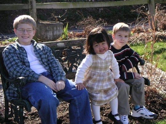 Zach Warrick, 12, left, Olivia, at 2, and Chandler