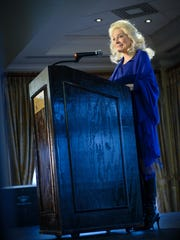 Singer, songwriter and activist Judy Collins speaks at a sold-out luncheon at Grey Oaks Country Club in Naples supporting the Collier County office of the National Alliance on Mental Illness on Friday, Dec. 8, 2017.