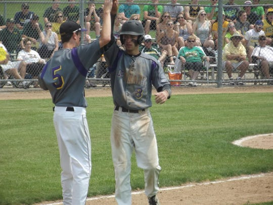 Denmark senior Tanner Umentum celebrates scoring a run in Denmark's 3-1 victory over Freedom on Tuesday in a WIAA Division 2 sectional semifinal game at Chilton.