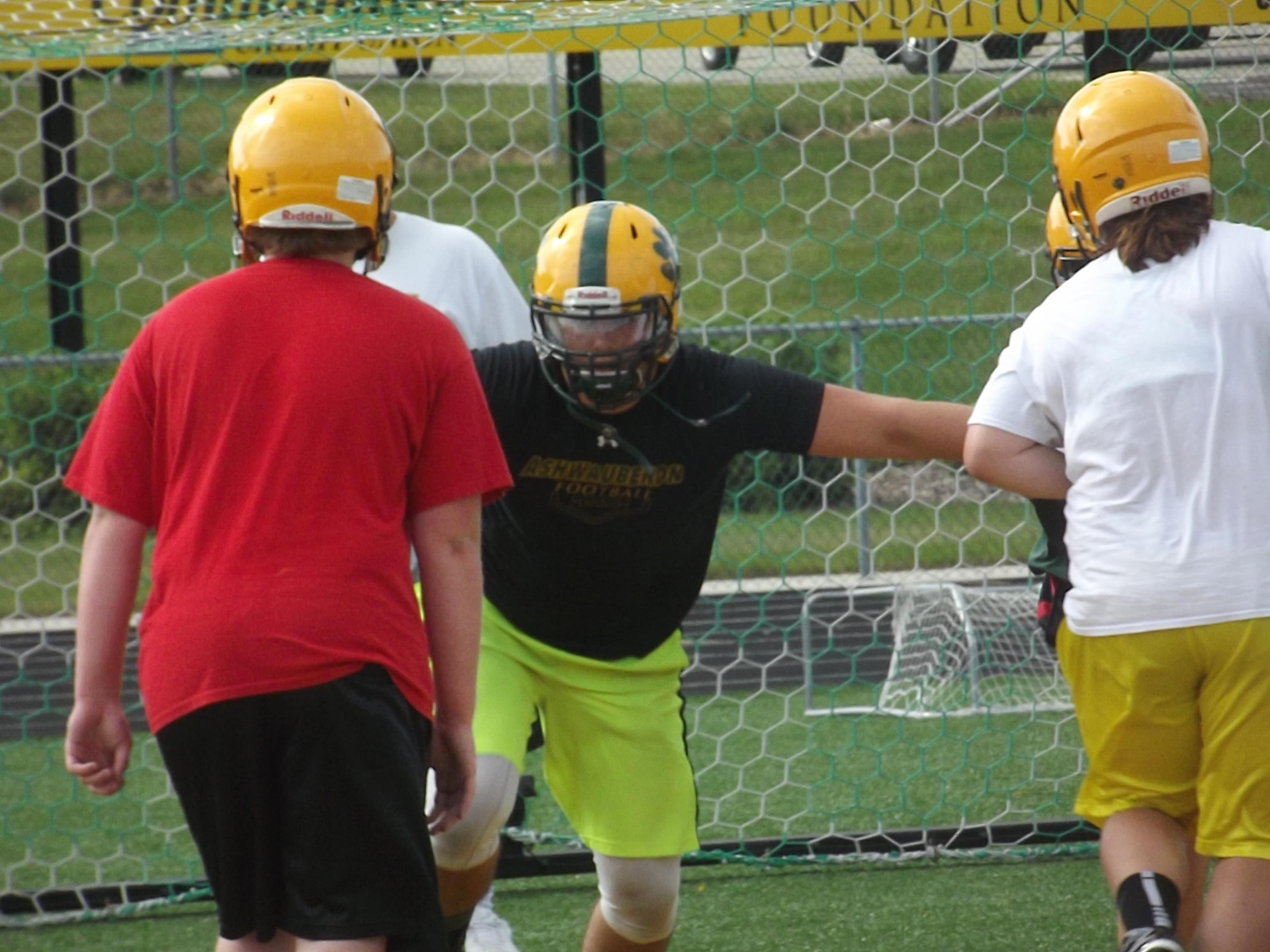 Ashwaubenon senior offensive lineman Airon Servais goes through a drill at practice Wednesday. Servais has 12 NCAA Division I scholarship offers.