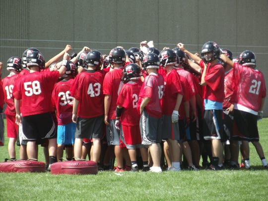 The Green Bay East football team huddles at the end of practice Wednesday. East is making the switch from the FRCC to the Bay Conference this year.