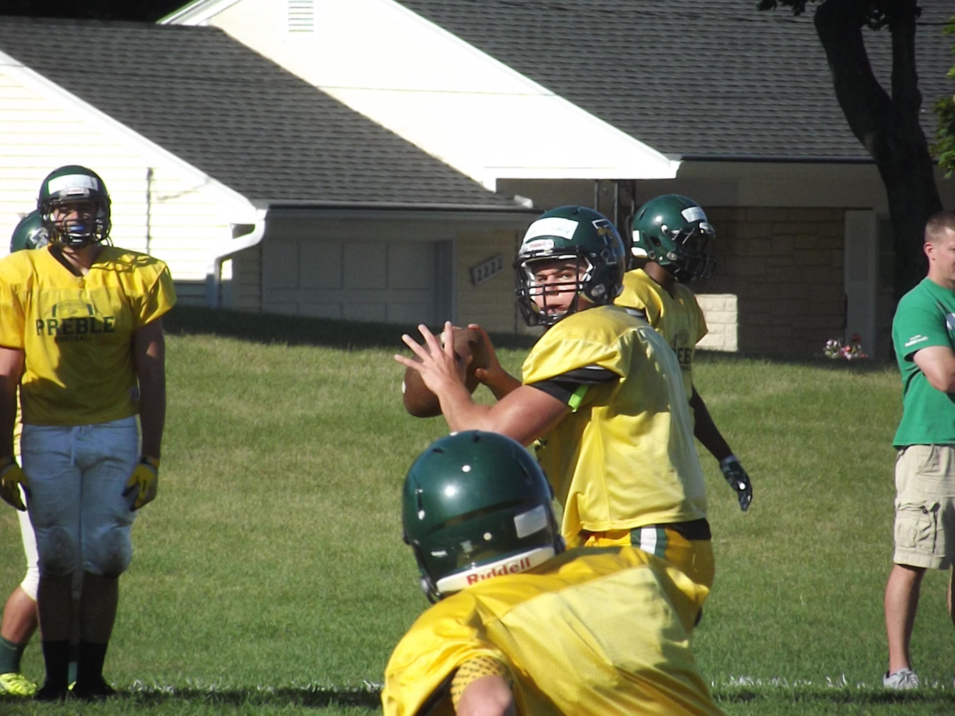 Green Bay Preble junior quarterback Coy Wanner gets ready to release a pass at practice Tuesday. Wanner is competing for playing time with senior Dylan Van Boxel.