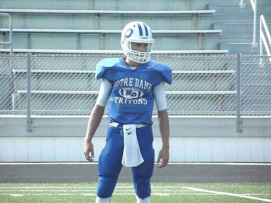 Green Bay Notre Dame senior Robert Petitjean is competing to replace Charlie Rotherham at quarterback.