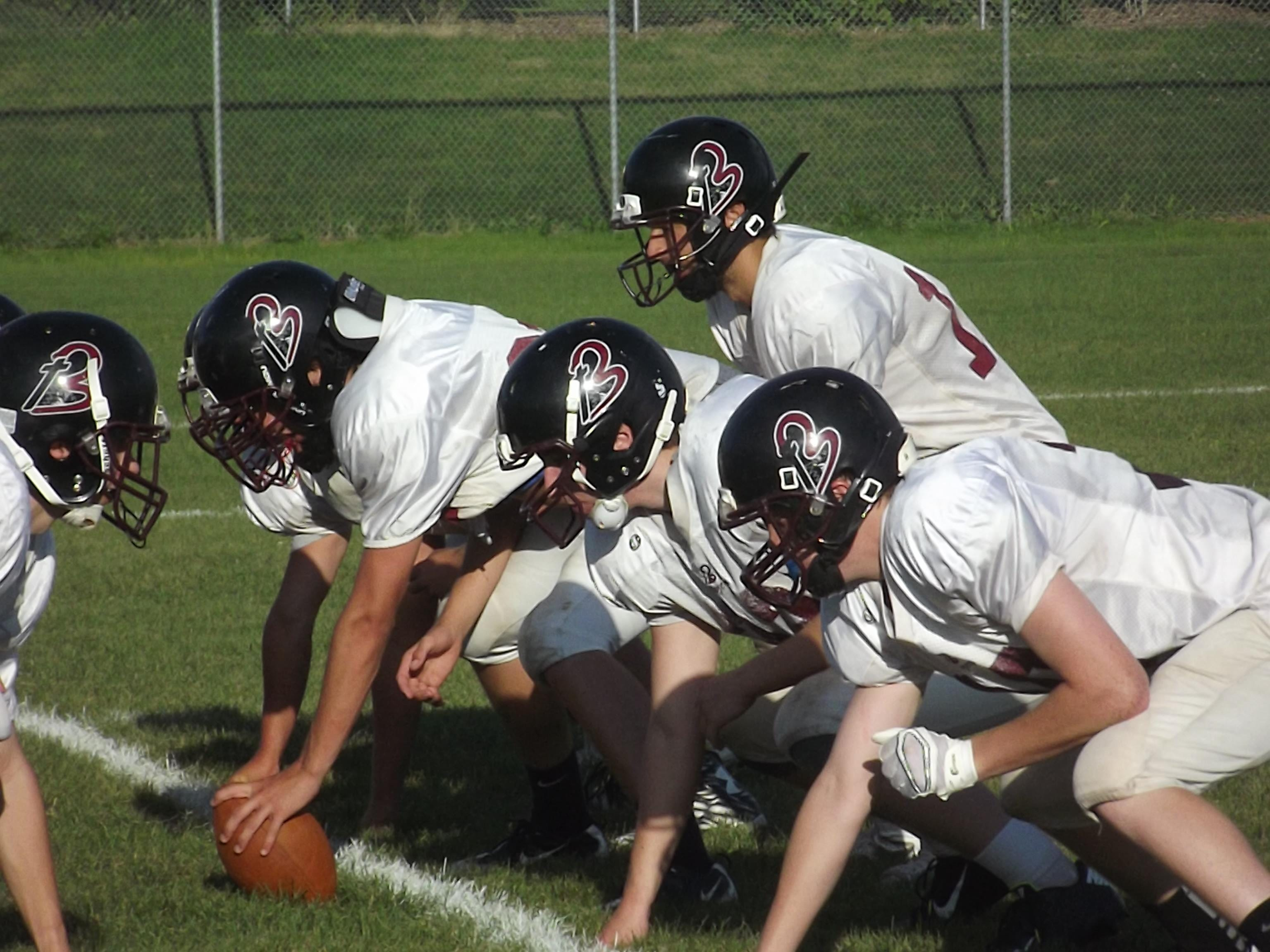 N.E.W. Lutheran James Lana gets ready to take a snap at practice Tuesday. Lana is replacing Noah Gosse at quarterback.