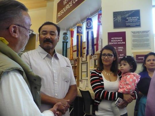 Juvencio Garcia, middle, and Daisy Almazan attend a