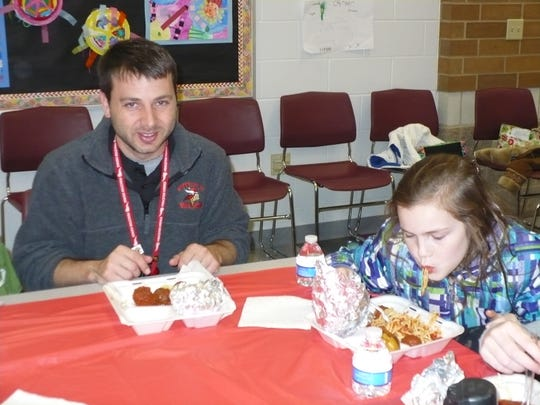 Sharonville Principal Jesse Kohls and fourth-grade student Maura Reilly enjoy their spaghetti luncheon provided by Angilo's. Reilly was one of the top 10 earning Blue Ribbons on Study Island in both Math and Reading.