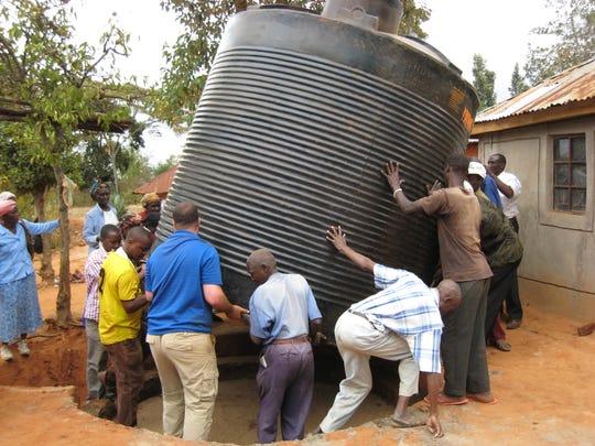 Installing cistern in Maiuni Village, Kenya