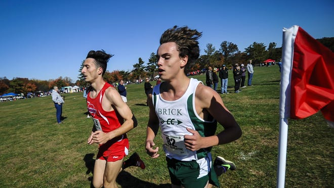 Ocean Township's Elliot Gindi, left and Damien Dilcher compete in the NJSIAA Cross Country Group III sectionals at Thompson Park in Jamesburg on Saturday..