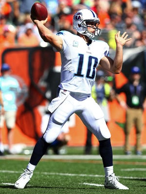 CINCINNATI, OH - SEPTEMBER 21:  Jake Locker #10 of the Tennessee Titans throws a pass during the third quarter against the Cincinnati Bengals at Paul Brown Stadium on September 21, 2014 in Cincinnati, Ohio. (Photo by Andy Lyons/Getty Images)
