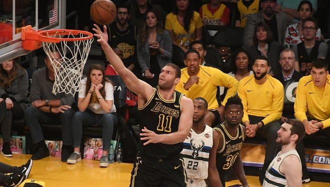 Lakers center Brook Lopez drives past Bucks forward Khris Middleton last season