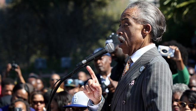 The Rev. Al Sharpton addresses a rally on March 10, 2014, in Tallahassee, Fla. Sharpton, the parents of Trayvon Martin and Jordan Davis and hundreds of others marched about a mile to Florida's Capitol against the state's stand your ground law.