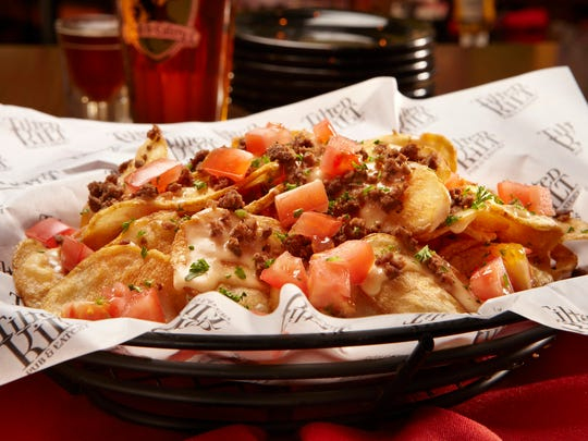 Veterans receive a complimentary appetizer, like the Irish Nachos, on May 24 at the Tilted Kilt.