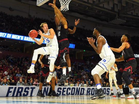 Duke's Luke Kennard looks to pass against Troy during
