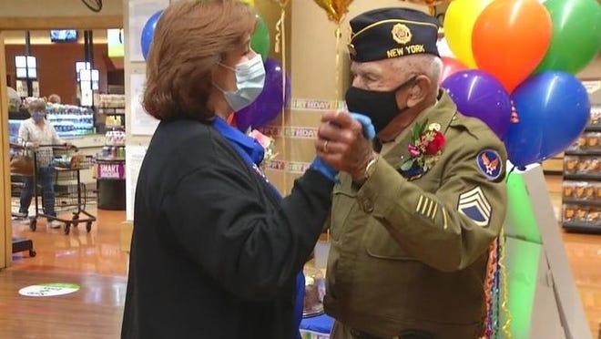 John C. Bryan celebrates his 101st birthday at the Canandaigua Wegmans on Sunday.
