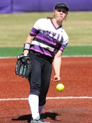 Wylie pitcher Kaylee Philipp (3) lets the ball go during the Lady Bulldogs' 4-1 loss to Brownwood on Tuesday, March 13, 2018.