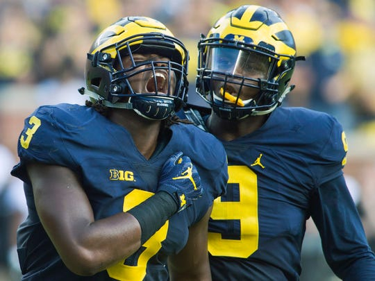Rashan Gary (left) celebrates a sack in 2016.