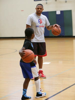 Cameron White gets ball handling lessons from Eric  Gordon, during the Eric  Gordon Basketball Camp, Monday June 8th, 2015. The camp was held at the JCC Indianapolis.