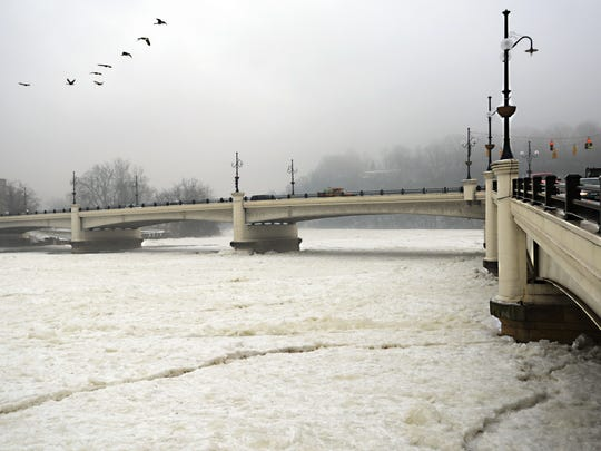 Ice choked the Muskingum River at the Y Bridge on Monday morning.
