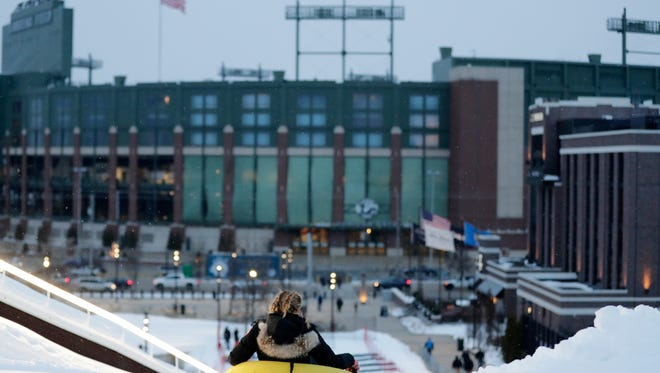 A tuber descends Ariens Hill in the Titletown District on Thursday, December 21, 2017 in Ashwaubenon, Wis. The hill opened to the public on Thursday.Adam Wesley/USA TODAY NETWORK-Wisconsin
