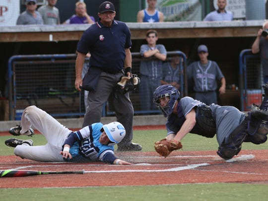 Adena's Russell Throckmorton slides into home plate Thursday night at Paint Stadium. Adena beat Chesapeake 7-0 in a Division III district semifinal.