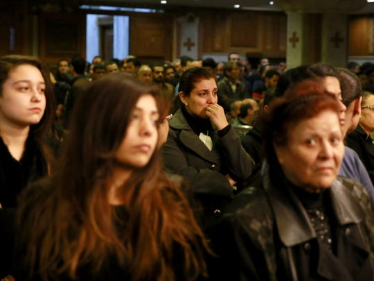 Egyptians gather during the funeral of the victims