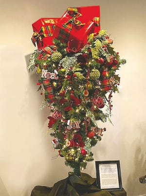 Lou Lynn Moss of The Flower Shoppe in Pratt decorated the winning Christmas entry in the Vernon Filley Art Museum's annual Festival of Trees, Wreaths and Decorations this season. Public votes selected the winner from 18 entries.