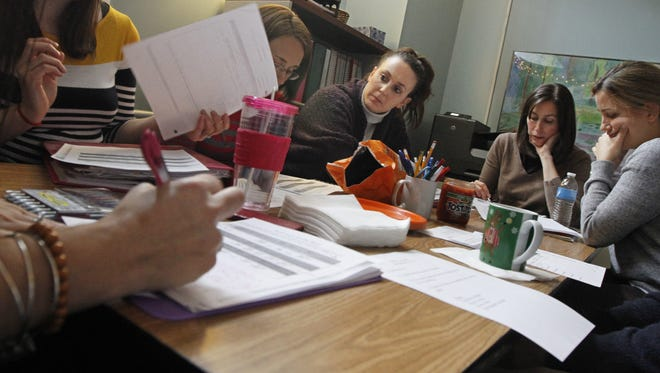 First grade teacher Danielle Fagnan, center, listens as other teachers give feedback and thoughts on her lesson plan during a bi-weekly Professional Learning Community K-2 meeting at the Urban Choice Charter School in Rochester.