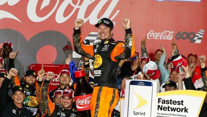 Martin Truex Jr. celebrates after winning  the Coca-Cola 600 at Charlotte Motor Speedway.