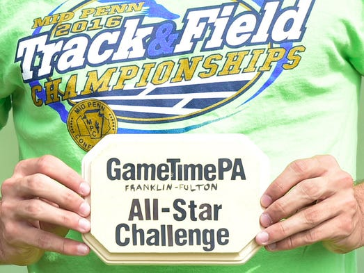 Liam Okal holds the GameTimePA.com plaque during the