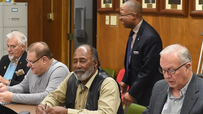 St. Landry Parish School Board members, from left, Huey Wyble, Kyle Boss, Anthony Standberry and Donnie Perron share a a light hearted moment with Superintendent Patrick Jenkins prior to the start of Thursday's special board meeting.