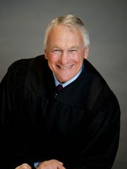 Justice Mike Wheat