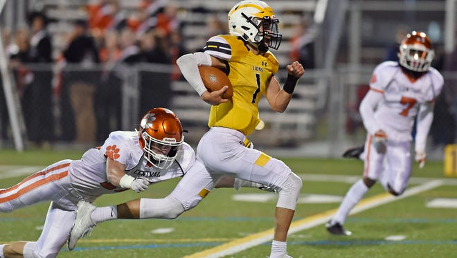 Red Lion quarterback Zach Throne keeps the ball against Central York in the second half of a YAIAA football game Friday, Oct. 20, 2017, at Red Lion. Central York won 24-21, delivering Red Lion their first defeat of the season.