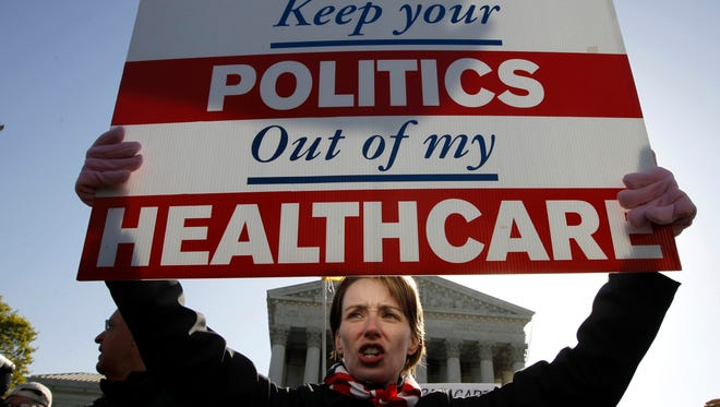 Amy Brighton from Medina, Ohio, protests  health care reform at the Supreme Court.