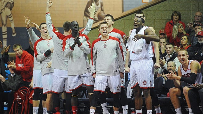 USD players react from the sidelines during a game against Florida Golf Coast Monday, Dec. 28, 2015, at the Sanford Pentagon in Sioux Falls.