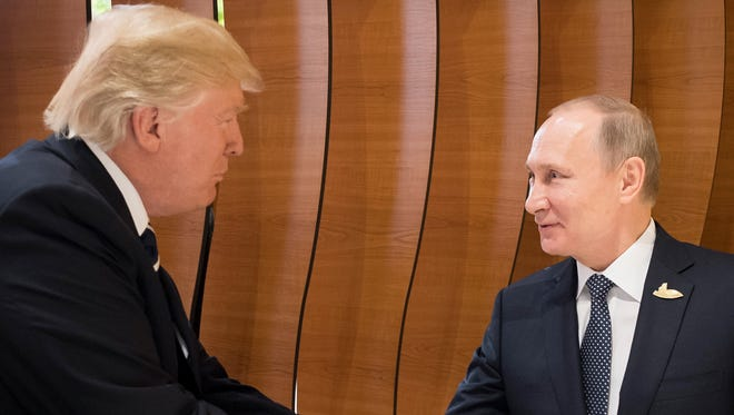 Trump and Putin shake hands at the retreat at the opening day of the G-20 summit in Hamburg, Germany on July 7, 2017.