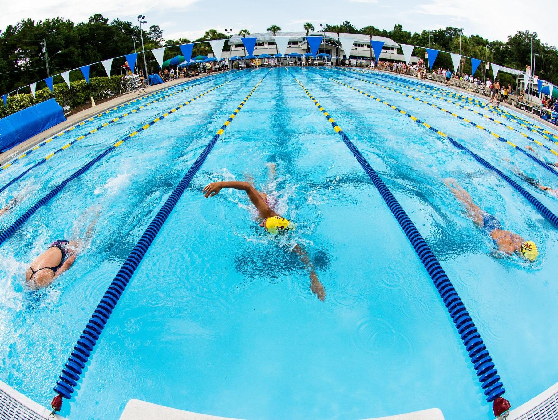 Lincoln junior Sara-Kellett Clark swims during ATAC's Long Course Invitational over the summer.