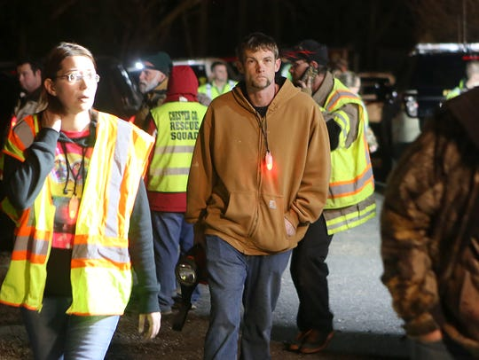 Law enforcement, first responders and volunteers search